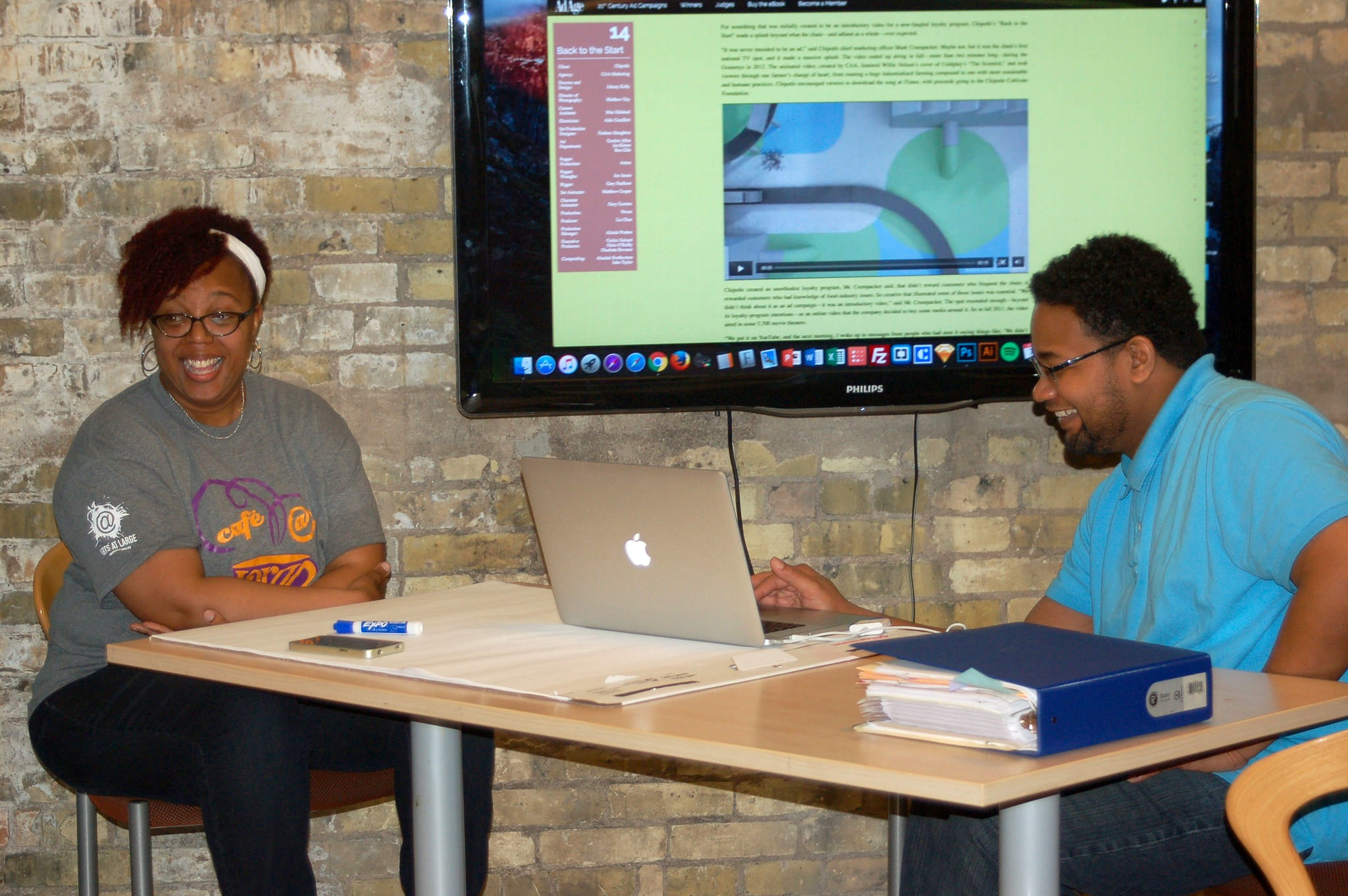 MKEGrind owners Sylvia and Thomas Wilson lead a workshop on branding for students at the Arts @ Large Gallery. (Photo by Andrea Waxman)