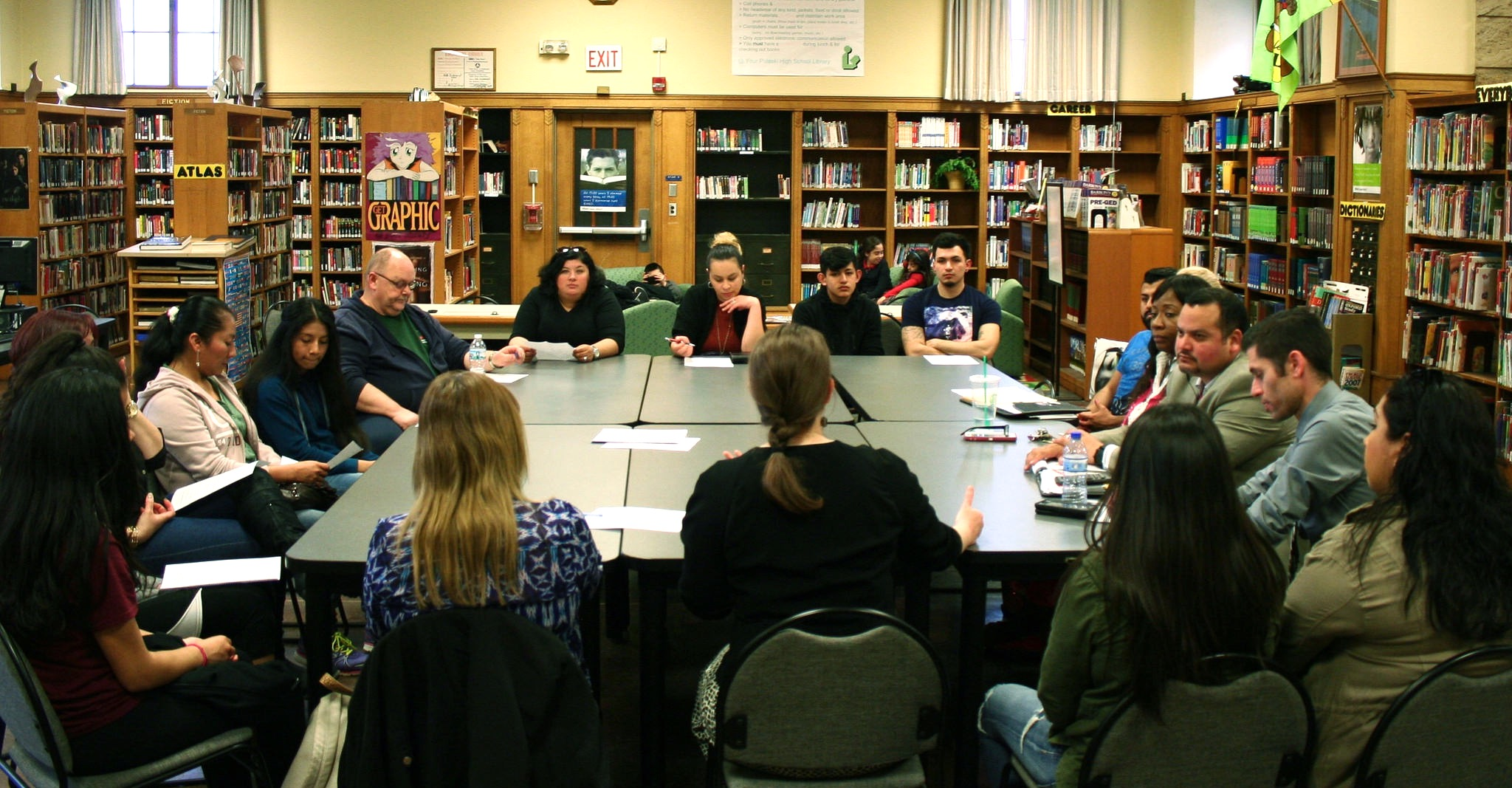 A group of staff, parents and students meet at the Pulaski library. (Photo by Jabril Faraj)