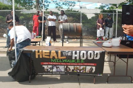 "The ""Heal the Hood"" banner was displayed on the food table at the block party. (Photo by Amelia Jones)"