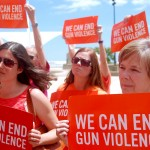 Gun violence awareness rally draws dozens clad in orange to downtown