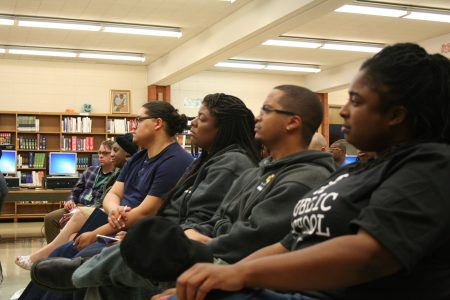 (From right) Ingrid Walker-Henry, Jamaal Smith, Martha De La Rosa and others listen to speakers during a community schools event at James Madison Academic Campus. (Photo by Jabril Faraj)