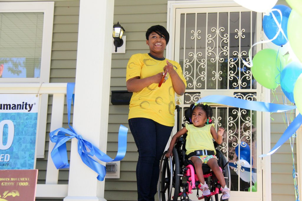 Deanna Brown and daughter in front of their new home (Photo by Jake Brandt, Milwaukee Habitat for Humanity)