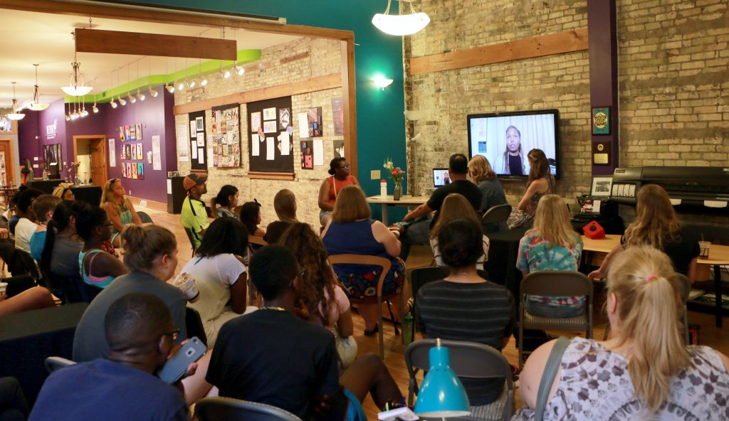 """Community members gather for the opening of """"We Speak: An Exhibition on Women's Rights."""" (Photo by Brianna Dorney)"""