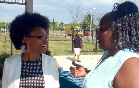 Delicia Morris (left), vice president of the Westlawn Resident Council Board, and Jackie Burrell, the board's president, chat during a reception at a recent Housing Authority of the City of Milwaukee annual meeting at Westlawn Gardens.