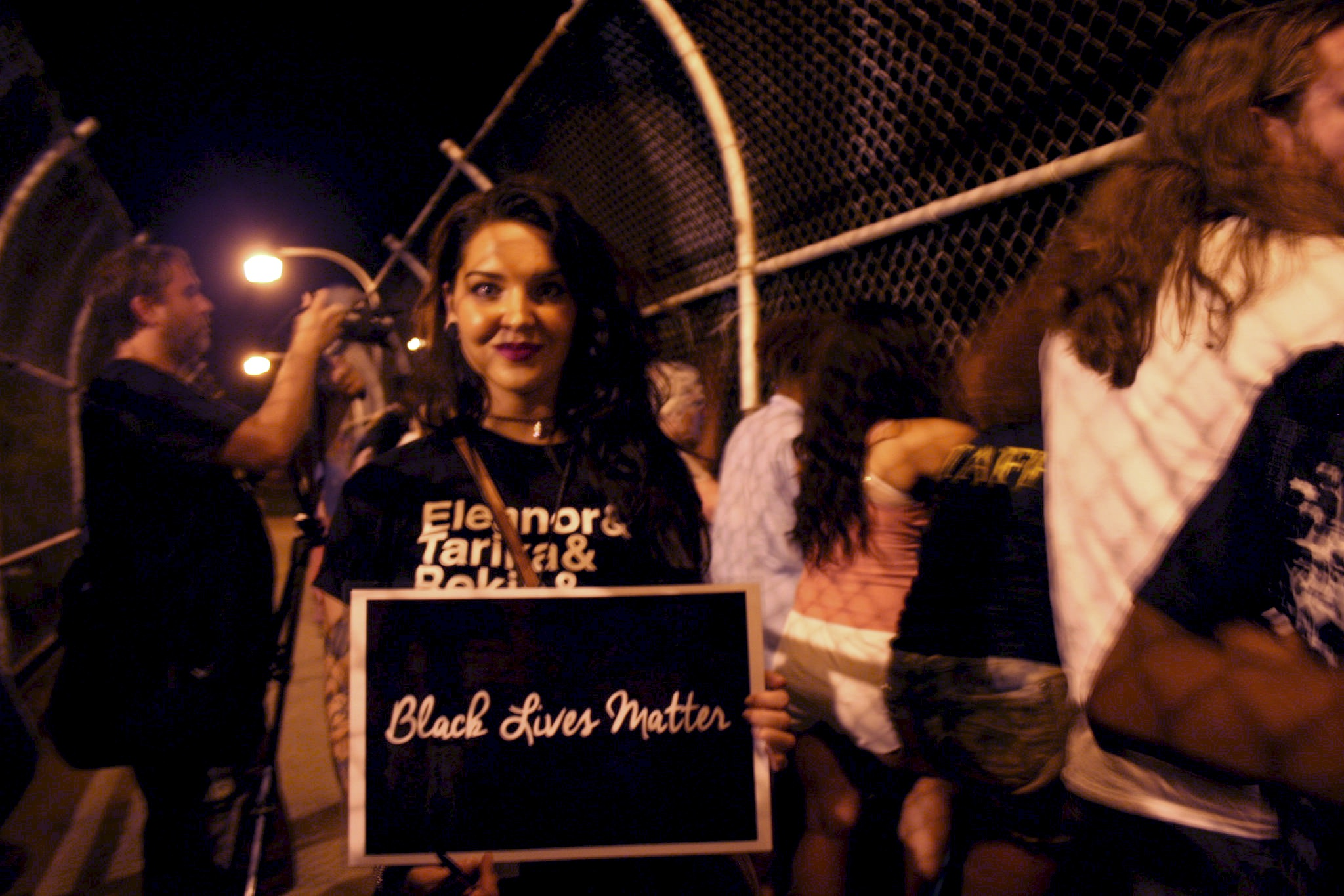 "Claire Van Fossen holds a ""Black Lives Matter"" sign during the demonstration. (Photo by Jabril Faraj)"