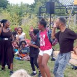 Diverse group gathers in Alice's Garden to address racial oppression