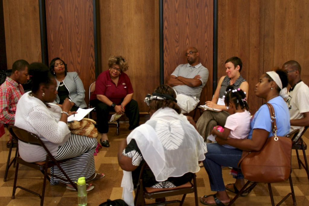 Attendees share stories in discussion circles during a recent listening session on police-community relations. (Photo by Jabril Faraj)