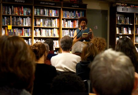 "Dasha Kelly reads from her novel, ""Almost Crimson,"" at Boswell Book Co. last year. (Photo by Adam Carr)"