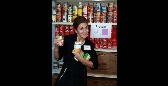 A volunteer helps out in the food pantry for Friedens Community Ministries.