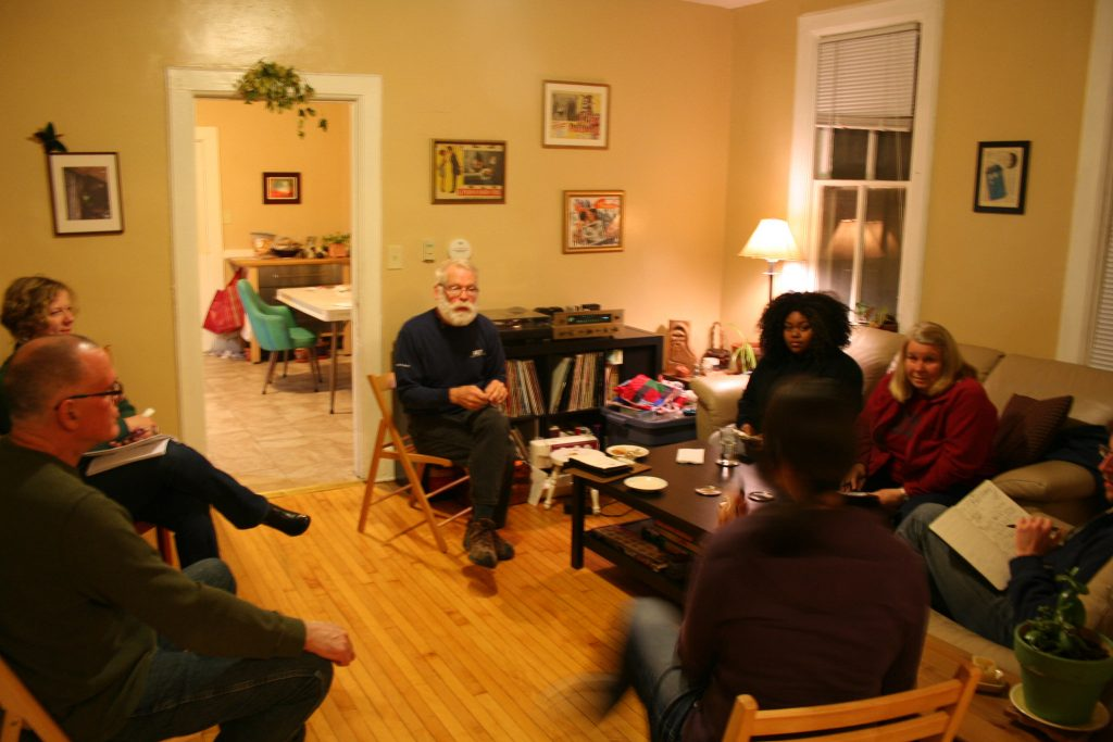 Ex Fabula fellows and other storytellers gather in McGee's first floor apartment. (Photo by Jabril Faraj)