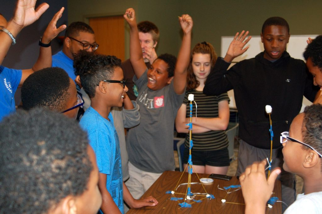"Winners of the ""marshmallow challenge"" celebrate their victory. (Photo by Andrea Waxman)"