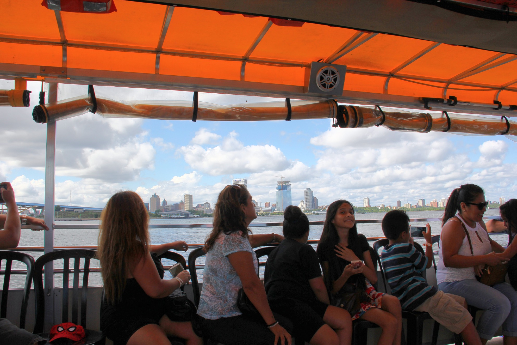 Passengers admire the Milwaukee skyline on a Harbor District Inc. boat tour.