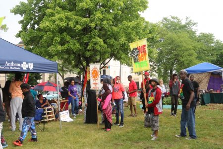 Community members gathered at the Peace Park & Garden after the march, where resource booths were set up. (Photo by Amelia Jones)