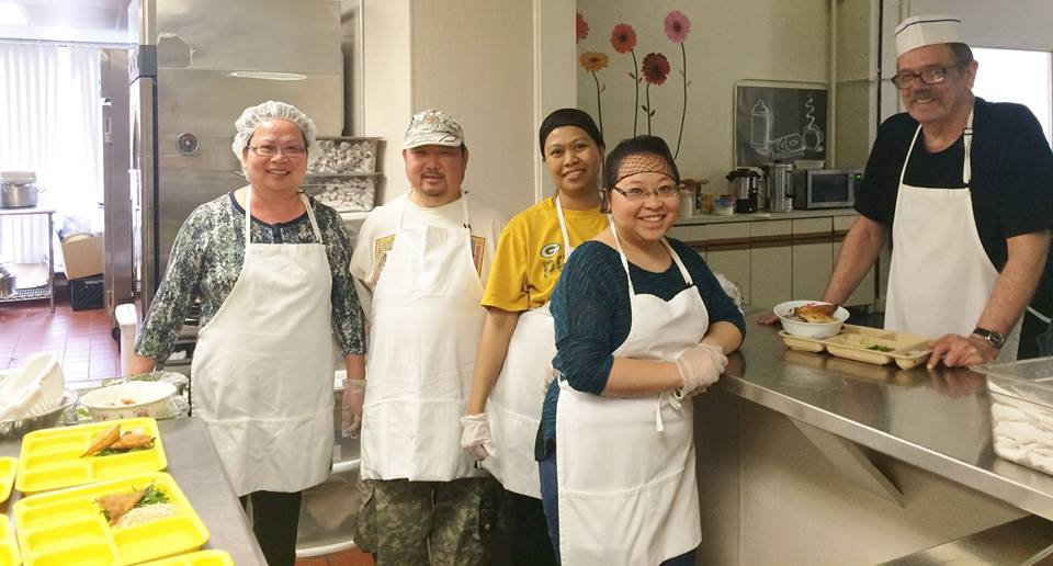 Volunteers help prepare meals for seniors at Milwaukee Christian Center.