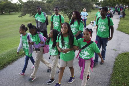 A group of children lead the UNCOM Walk for Wellness to support healthier living, in September 2015. (Photo by Emmy A. Yates)