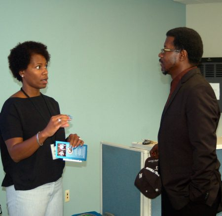 Milwaukee Police Department recruiter Katrina Warren discusses employment opportunities with Daniel Cotton. (Photo by Naomi Waxman)