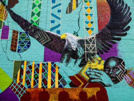 A young black boy is illustrated setting an eagle free. (Photo by Allison Steines)