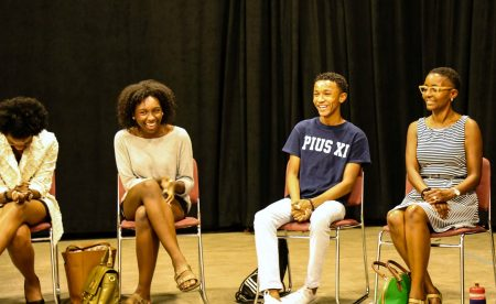 (From left) Shontra Powell, Zoe Powell, Cole Hines and Janel Hines share a laugh when introducing themselves. (Photo by Allison Steines)