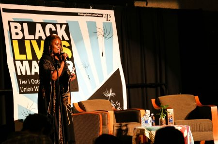 Moderator and UWM doctoral student Charmaine Lang announced Black Lives Matter speakers Alicia Garza and Patrisse Cullors. (Photo by Allison Steines)