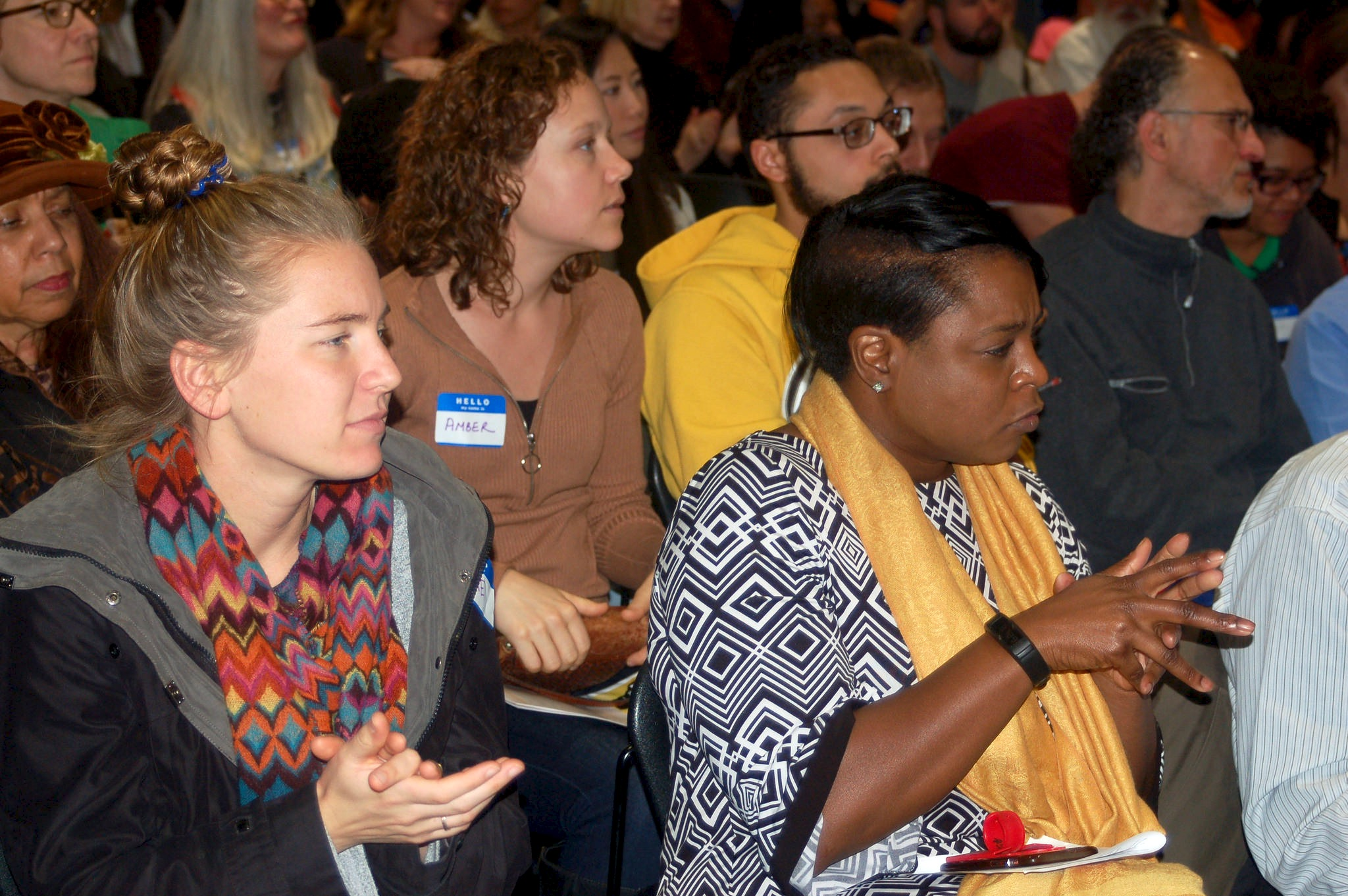 The audience listens attentively as panelists discuss the history of institutional racism in Milwaukee. (Photo by Naomi Waxman)