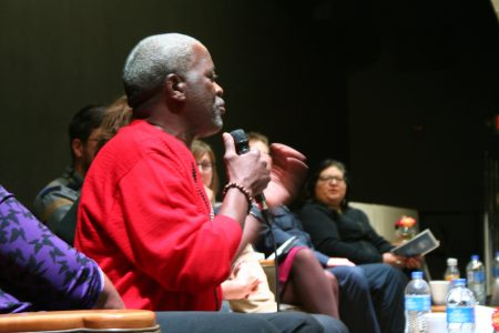 Andre Lee Ellis speaks from the stage during a panel discussion at a recent UEDA summit. (Photo by Jabril Faraj)