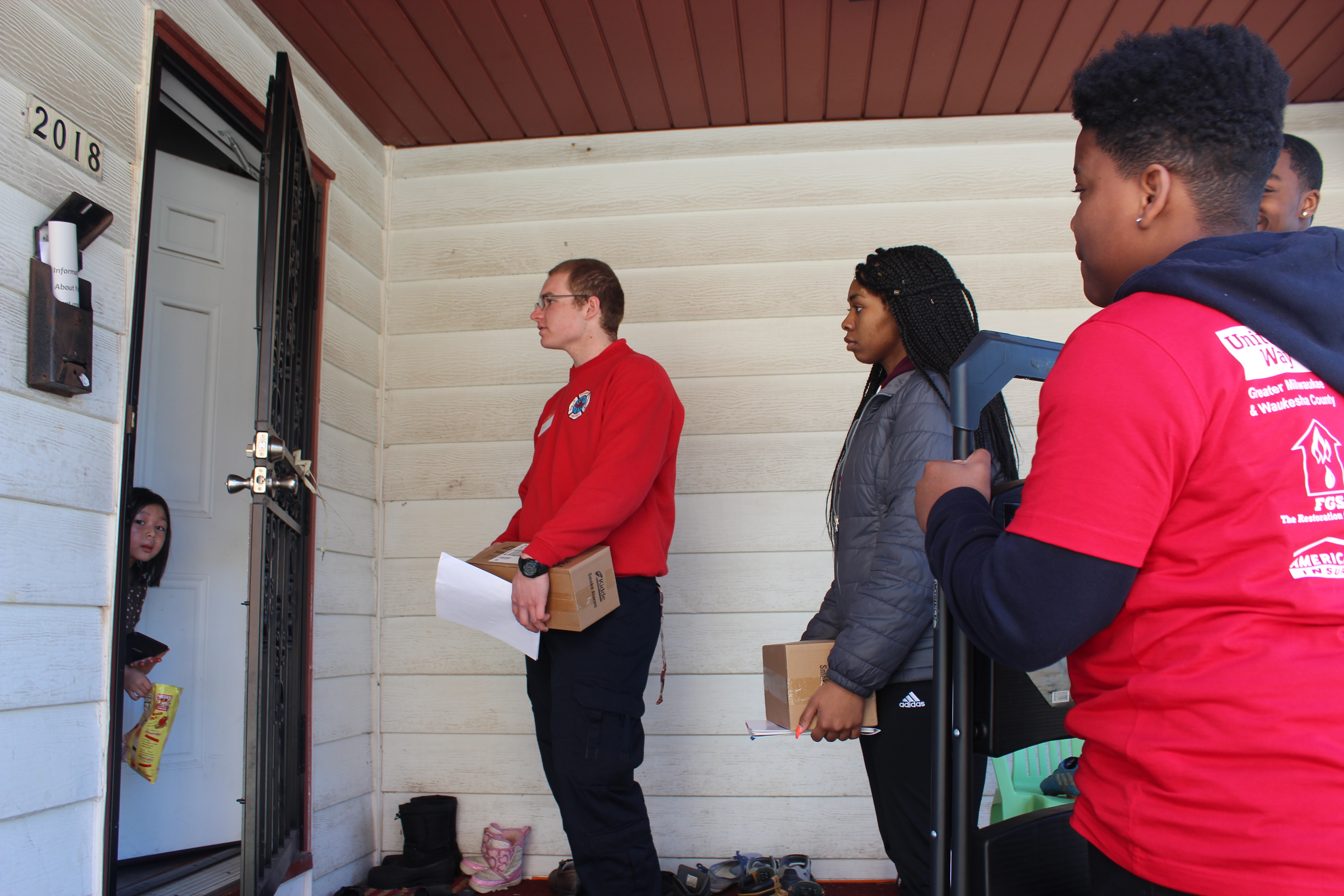 Volunteers install free smoke alarms for South the Alarm initiative