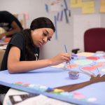 ArtWorks interns from Garden Homes create murals for MMSD storm water project