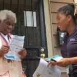 Canvassers go door to door to warn Amani residents about lead dangers