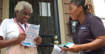 Canvassers go door to door to warn Amani residents about lead dangers