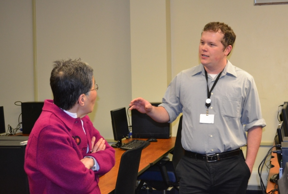 SDC Commissioner CJ Kim learns about the new testing center from SDC staffer Jake Gorges.