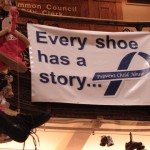 City Hall exhibit helps others walk in the shoes of child abuse victims