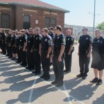 Police roll call welcomes neighbors to Oasis meal program