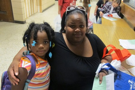 Valerie Reid and her daughter Savannah, 6, left the fair with school supplies and health information. (Photo by Edgar Mendez)