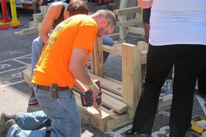 Volunteers build a wooden bench for a KaBOOM! playground at the Northside YMCA. (Photo by Shakara Robinson)