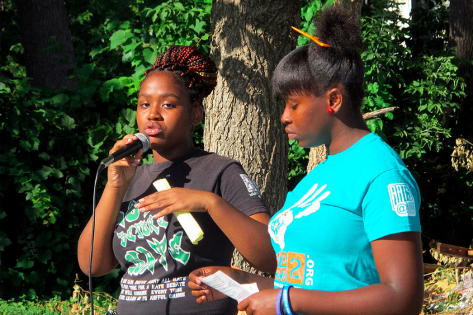 Westside Academy students Vanisha Wallace-Nelson (left) and Leora Wells address the gathering at the Fox Field Community Celebration for Peace. (Photo by Andrea Waxman)