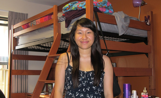 Panou Xiong sets up her room in Marquette's Cobeen Hall. (Photo by Andrea Waxman)