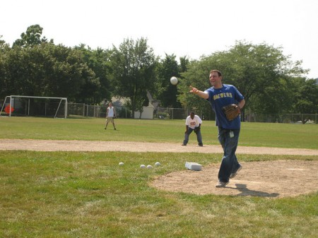 Assistant District Attorney Christopher Ladwig throws a pitch in the six-inning game. (Photo by Rick Brown)
