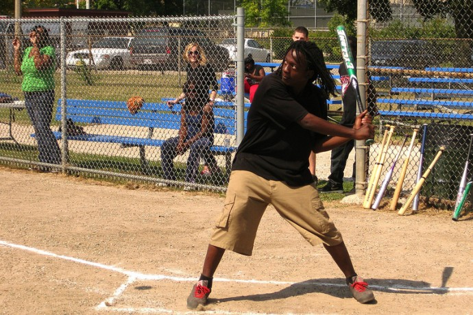 North Side resident Kevin Windom takes a batting stance at Next Door Foundation's community safety softball game at Merrill Park. (Photo by Rick Brown)