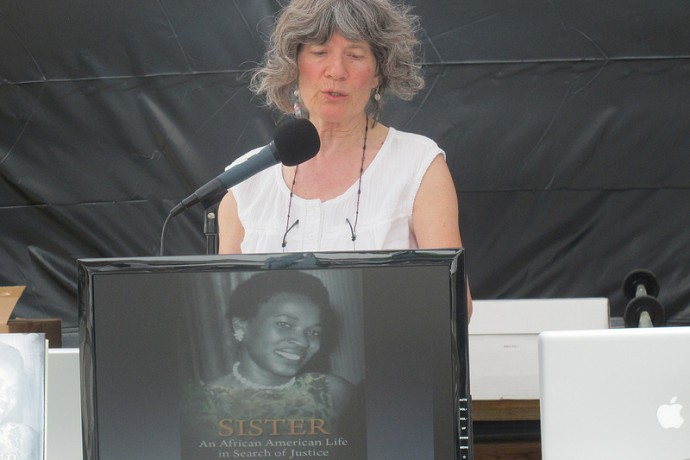 Jody LePage shares the story of Sylvia Bell White, a civil rights activist and former Fondy Food Market vendor, at the recent Haymarket Days Celebration. (Photo by Shakara Robinson)