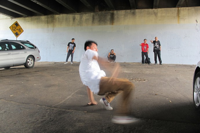 """B-Boy Archie"" preps for the break dancing contest under the 35th Street viaduct. (Photo by Edgar Mendez)"