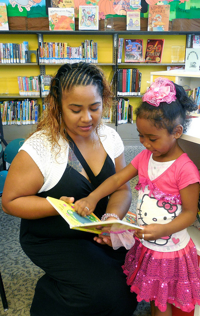 Guadalupe Bedolla and her 4-year-old daughter, Rihanna, visit the Forest Home library every other weekend to check out children's books. (Photo by Maria Corpus)