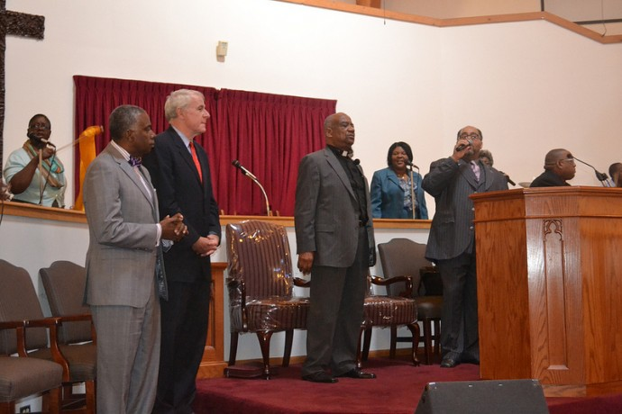 Commissioner of Health Bevan K. Baker (left) and Mayor Tom Barrett wait to speak on safe sleep at Ebenezer Church. (Photo by Tom Momberg)
