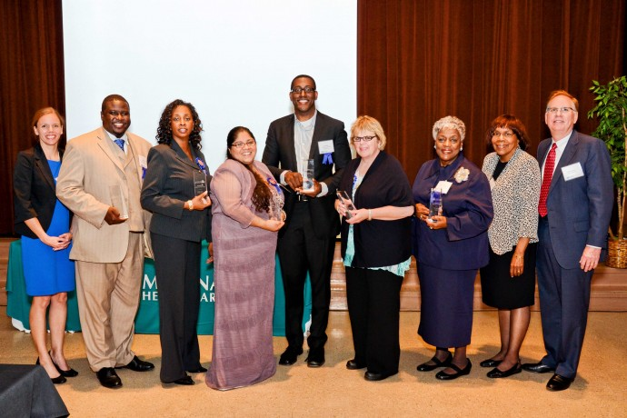 (l-r) Elizabeth Benz, community outreach director for Molina Healthcare; Quentin Grant, award winner; Linda Wade, award winner; Patricia Ruiz-Cantu, award winner; Tyrone Miller, award winner; Mary Marks, award winner; Jynette Hamilton, award winner; unknown; and Scott Johnson, president of Molina Healthcare of Wisconsin.