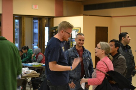 Ben York (left) and Mary Flynn, Lutheran Social Services of Milwaukee program supervisor (right) chat with guests. (Photo by Tom Momberg)