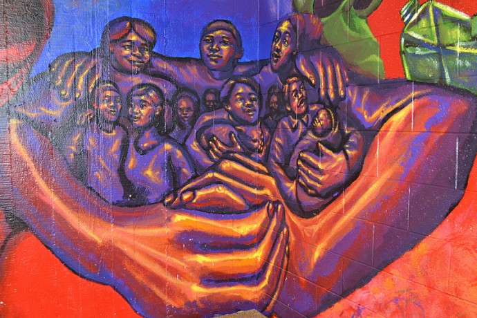 A mural at Neighborhood House of Milwaukee captures the spirit of the settlement house. (Photo by Sue Vliet.