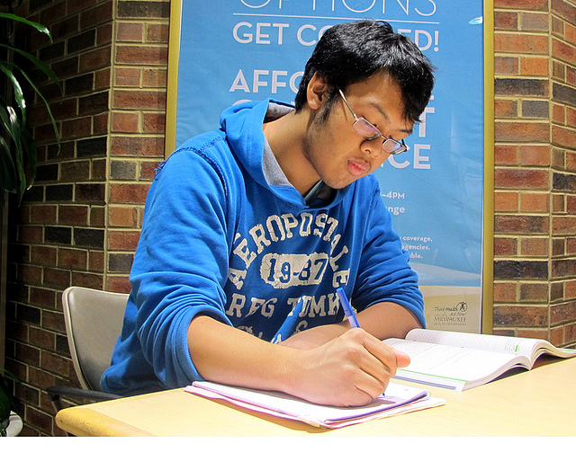 Peter Khanthavong reviews class notes in the UWM Student Union. (Photo by Andrea Waxman)