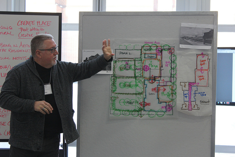 James Steiner of Quorum Architects explains design drawings for Site 4, the location of the former Garfield Avenue School. (Photo by Mark Doremus)