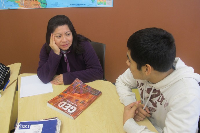 Volunteer math tutor Elizear Hurtado (right), helped Josefina Mendoza prepare for her GED math test in December. (Photo by Edgar Mendez)