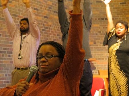 Venice Williams leads deep breathing exercises before a panel discussion on food justice. (Photo by Karen Stokes)
