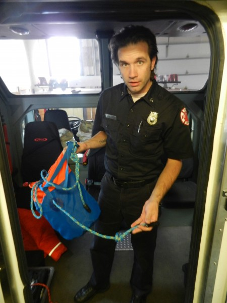 Schutte checks out equipment at Engine 3, which houses the Dive Rescue team. (Photo by Kevin Ward)